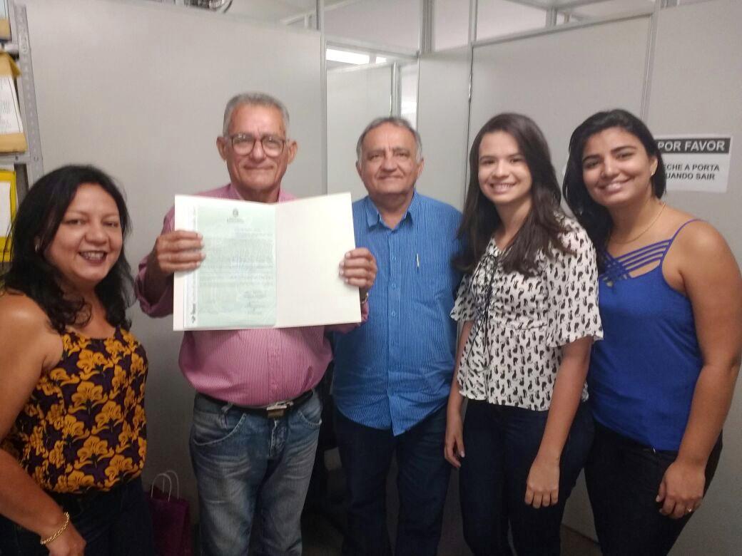 Seu João Araújo, diretor e equipe de titulação